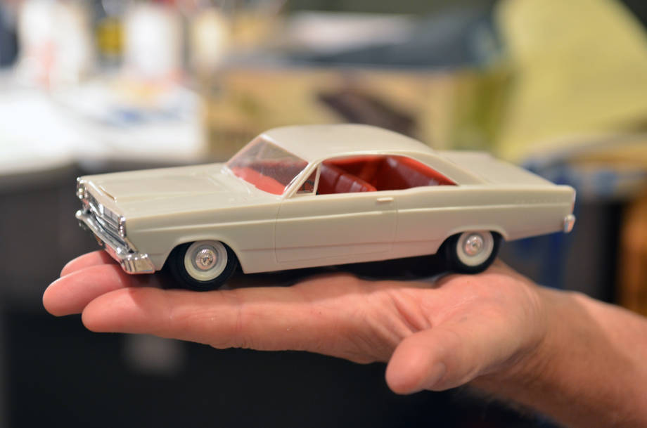 Jim Reese holds up a model car version of a Ford Fairlane. Reese is an active member in a local model club that hosts an event at HIckman High School where kids can build a snap-tight model at no cost.
