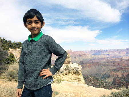Saathvik Kannan, seen here in front of the Grand Canyon in 2014, has academic and research aspirations like his parents.