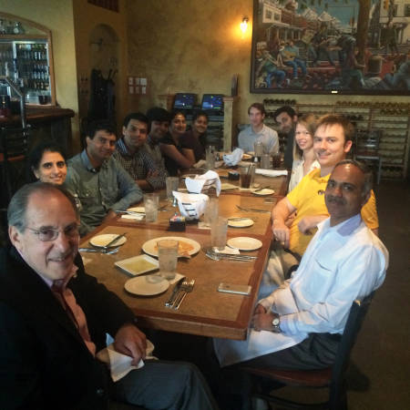 Donor Dr. Michael Bukstein, who sponsors Kannan's cancer research, enjoys a meal with the professor's research team. From left to right: Dr. Bukstein, Anandhi Upendran, Dhananjay Suresh, Ajit Zambre, Purushotham Koppula, Shreya Ghoshdastidar, Sandhya Saranathan, Jabez Campbell, Srikar Raman, Hannah Moore, Chuck Caldwell and Kannan. Photo courtesy of Raghu Kannan.