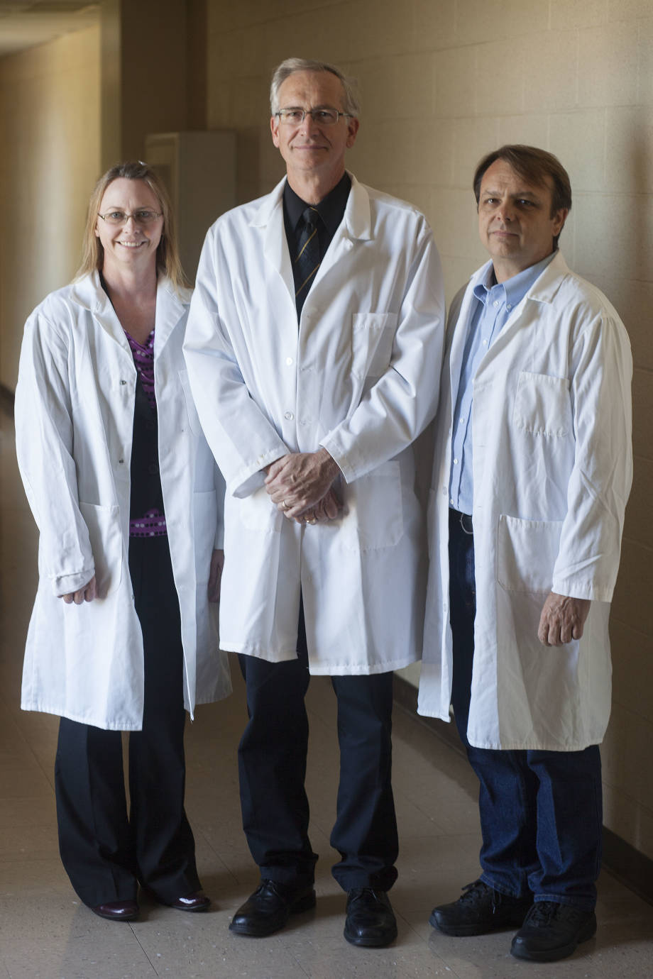 A research team lead by the trio of (from left to right) Kristin Whitworth, Randall Prather and Kevin Wells has been able to accelerate their overall work through the CRISPR Cas9 system. Photo courtesy of Mizzou News Bureau.