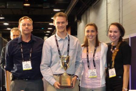 Coach Rick Lindhart and team members Adam Berge, Courtney Kleekamp and Julianna Kubiak pose with their trophy. Photo courtesy of Rick Lindhart.