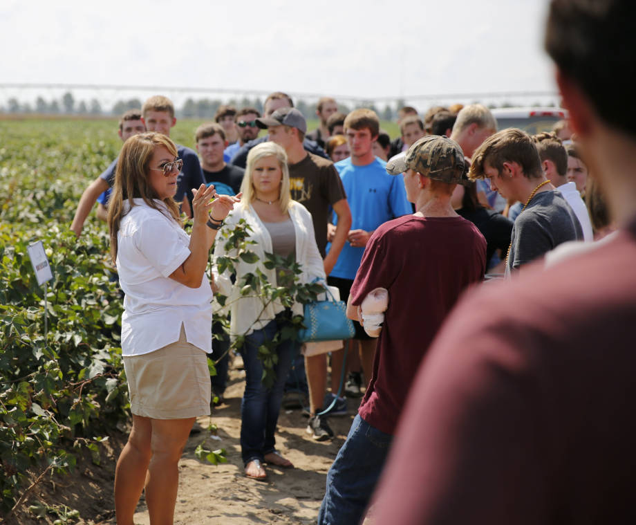 Andrea Jones discusses cotton with a group of high school students during the Fisher Delta Research Center Agriculture Education Day.