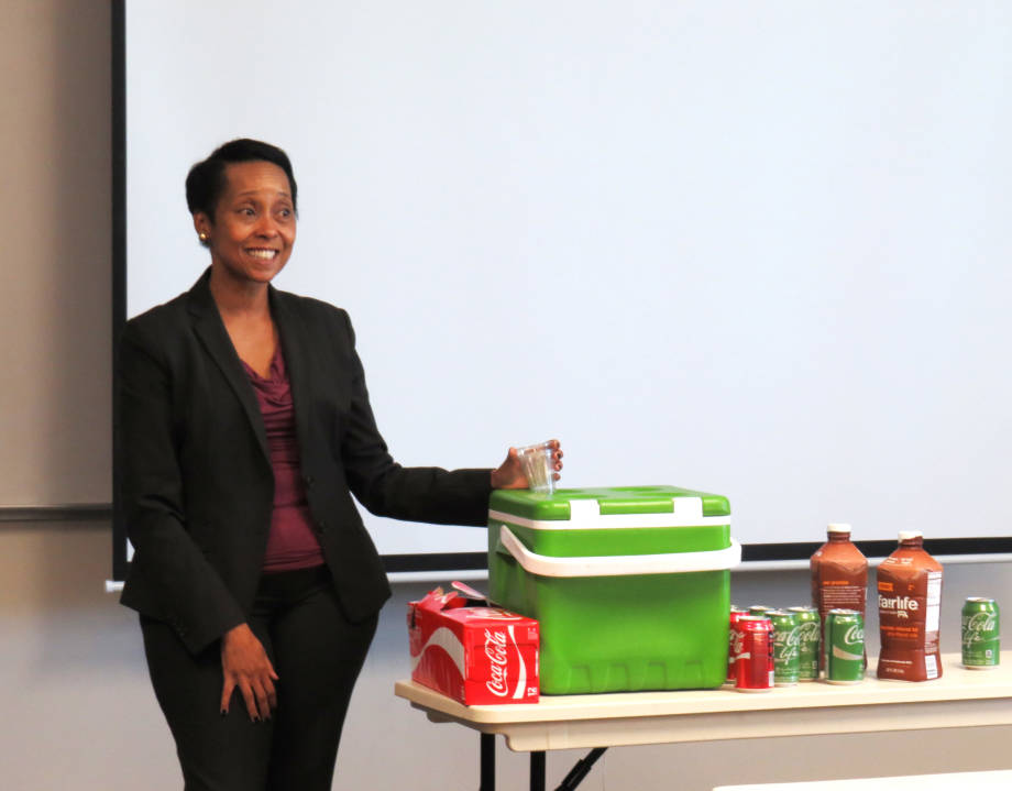 Wamwari Waichungo, vice president of global scientific and regulatory affairs at The Coca-Cola Company, presents products to students.