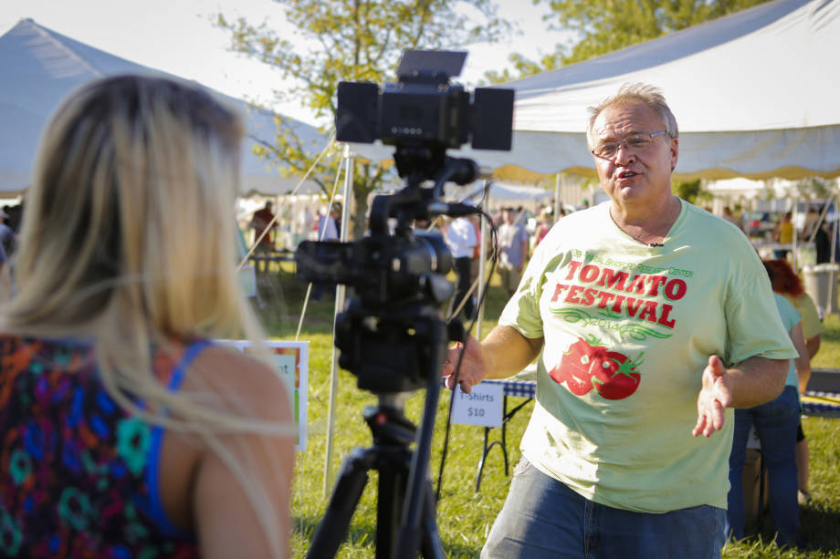 Tim Reinbott discusses the Tomato Festival with the media. The Tomato Festival was one of the most popular events that the Bradford Research Center hosted.