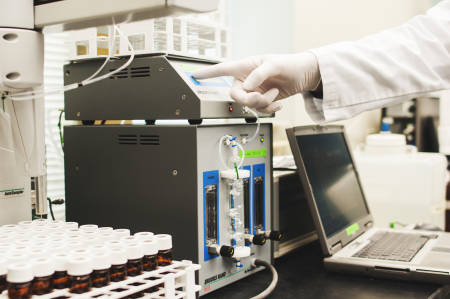 Ryan Harvey, a doctoral student who works as a research assistant in Judy Wall's laboratory, demonstrates how specialized machine known as the MerX can measure the amount of methylmercy in a given sample.