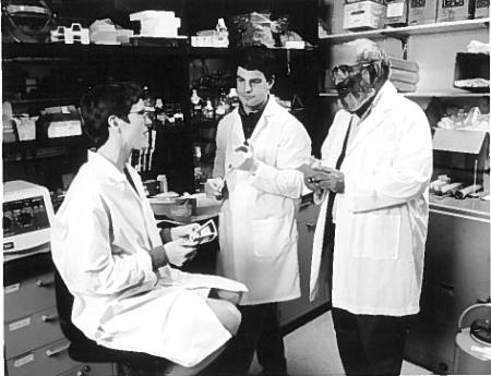 Charlotte Phillips, left, associate professor of biochemistry, works in a lab in this photo from the biochemistry archives.
