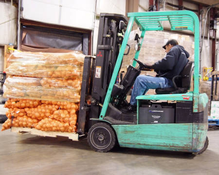 A worker loads up a large haul at the central warehouse of The Food Bank for Central & Northeast Missouri. Photo courtesy of The Food Bank.