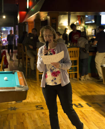 Sheri Freyermuth, assistant dean for academic programs, announces the next set of games on the bracket.