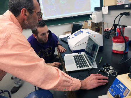 John Tanner, professor of biochemistry, works with student Seth Pratt on analyzing data from a recent X-ray crystallography class module. Photo courtesy of Lesa Beamer.