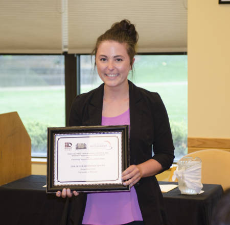 Junior Jacquelyn Lizar poses with her Missouri Restaurant Association scholarship certificate.