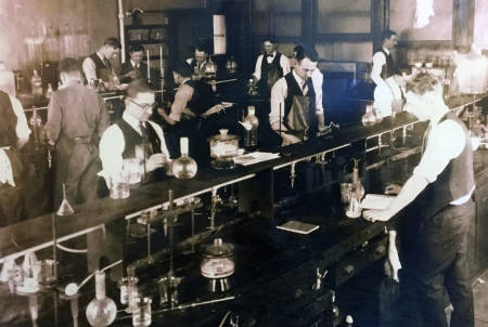 A group of biochemistry researchers analyze fertilizers for potash (the nutrient form of potassium) in the early days of Schweitzer Hall. Photo courtesy of the biochemistry department.