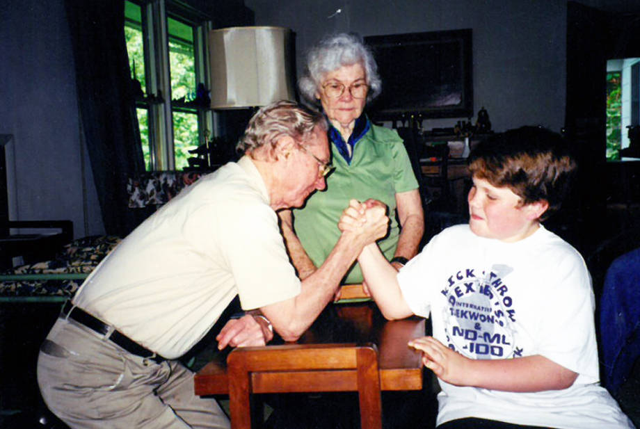 Boyd O'Dell arm wrestles his grandson, Barry, in the early 90s. Photo courtesy of Ann O'Dell.