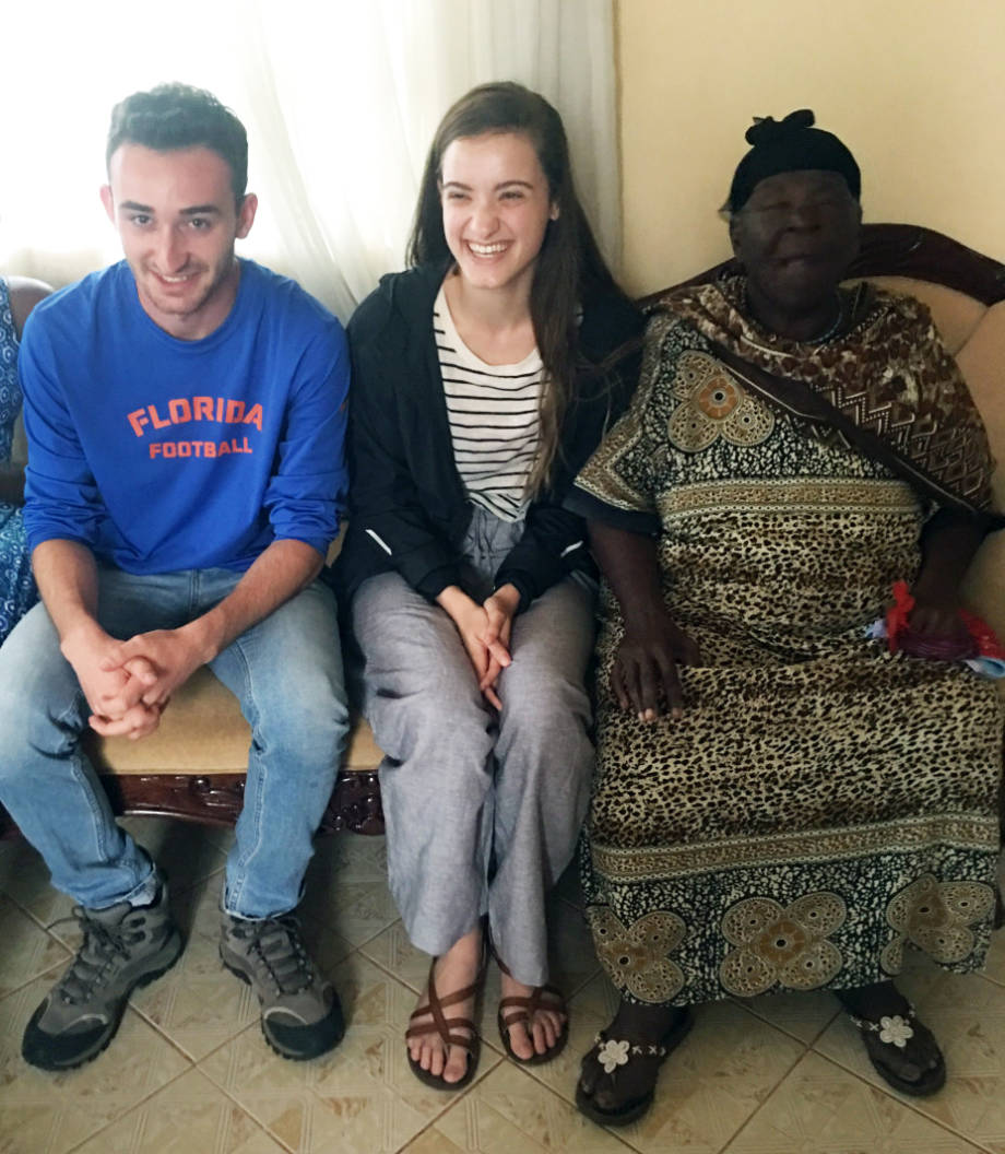 Holly Enowski sits with Sarah Obama, the grandmother of President Barack Obama. To the left of her is her fellow intern, Isaac Mirti. Photo courtesy of Holly Enowski.
