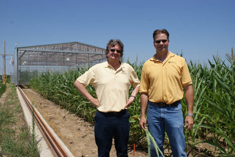 Bob Sharp, left, and Felix Fritschi stand at Bradford Research Center with a drought simulator in the background in this photo from 2014. Photo by Randy Mertens.