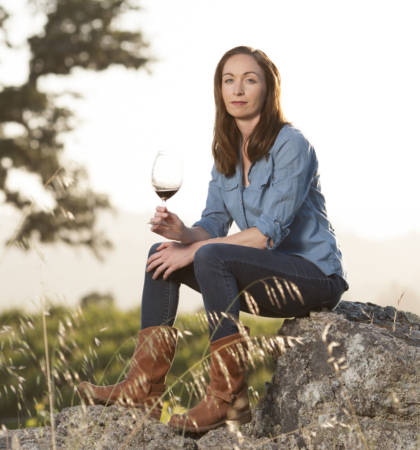 Kristina poses with a glass of wine. After working in wine internationally, she has settled in California where she crafts cabernets. Photo courtesy of Kristina Werner.