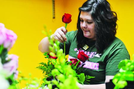 Tiger Garden employees prepare a massive order of floral arrangements for customer pickups on Friday, Feb. 13, 2015. Photo by Morgan Lieberman | © 2015 - Curators of the University of Missouri