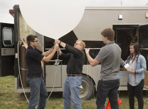 Launching a weather balloon.