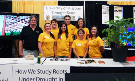 A group of graduate students and post doctoral fellows working on the nodal root research (pictured with Bob Sharp and Felix Fritschi) talked to a wide array of people about their work at the Governor's, Legistlators' and Judges' Day at the Missouri State Fair. Photo courtesy of Bob Sharp.