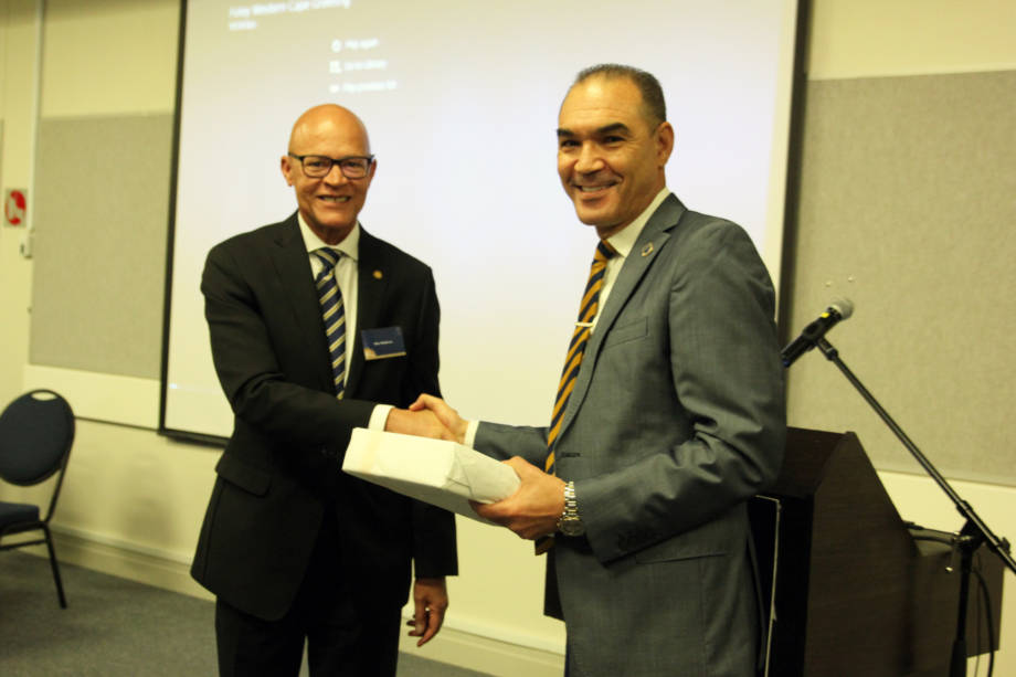 Mike Middleton, UM System interim president, and Tyrone Pretorius, UWC rector and chancellor, shake hands during the event that honored the 30th year of the partnership between the two institutions last May on the UWC campus. Photo courtesy of the University of the Western Cape.