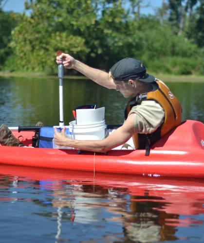 Water sampling from a kayak.