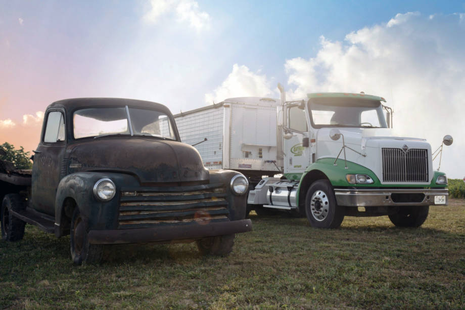 A truck from early days of Clay Farms sits next to its modern counterpart at the recent 200th anniversary celebration of the farm. Photo courtesy of Linda Nivens.