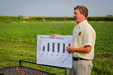 Matthew Caldwell, graduate student, speaks about impregnated fertilizers on corn and soybeans.