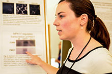 A graduate student during a poster session