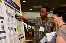 Morgan Halane discusses his research project More Than Secretion. His poster displays his work on exploring the functions of the N terminus of the processed pathogen effector AvrRps4.