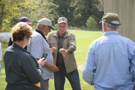 Gregory Ormsby Mori talks to attendees about growing shiitake and other mushrooms during the Wurdack Research Center Field Day, which took place Friday, Oct. 7 in Cook Station.