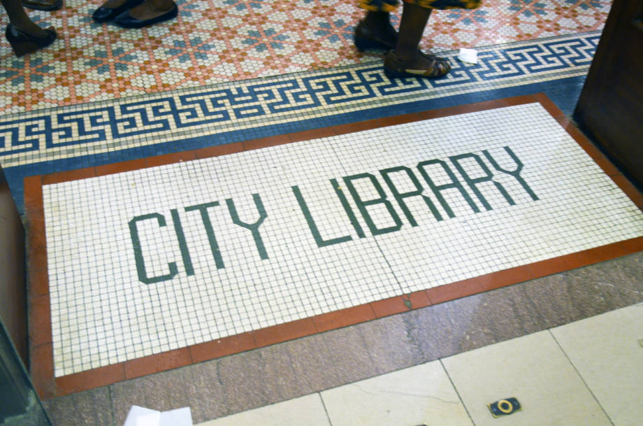 The tiles leading into the lobby of the World Food Prize Hall of Laureates remain from when the building served as Des Moines City Library.