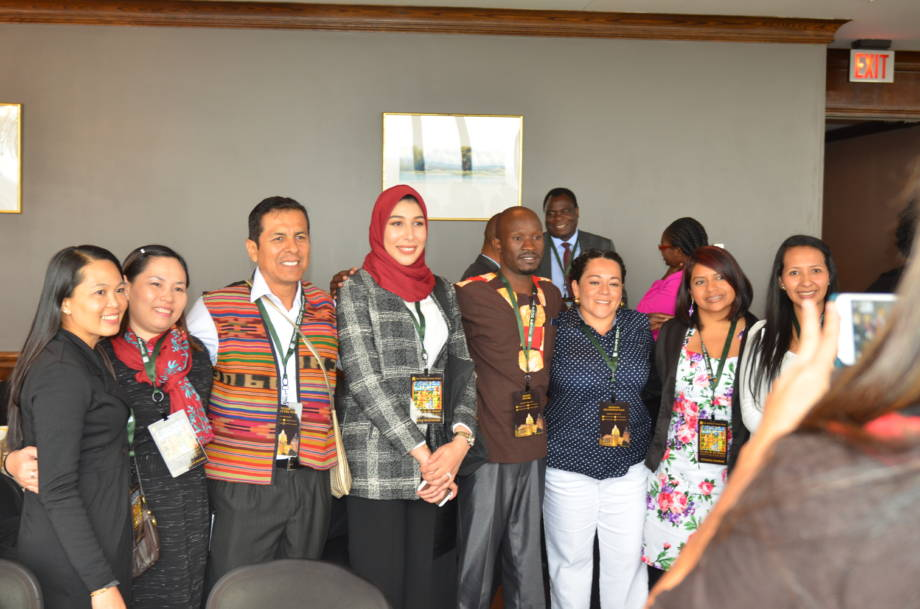 Hajar Bourhan, a Bourlaug Fellow from Morocco currently studying at the University of Missouri, takes a group photo with other Borlaug Fellows.
