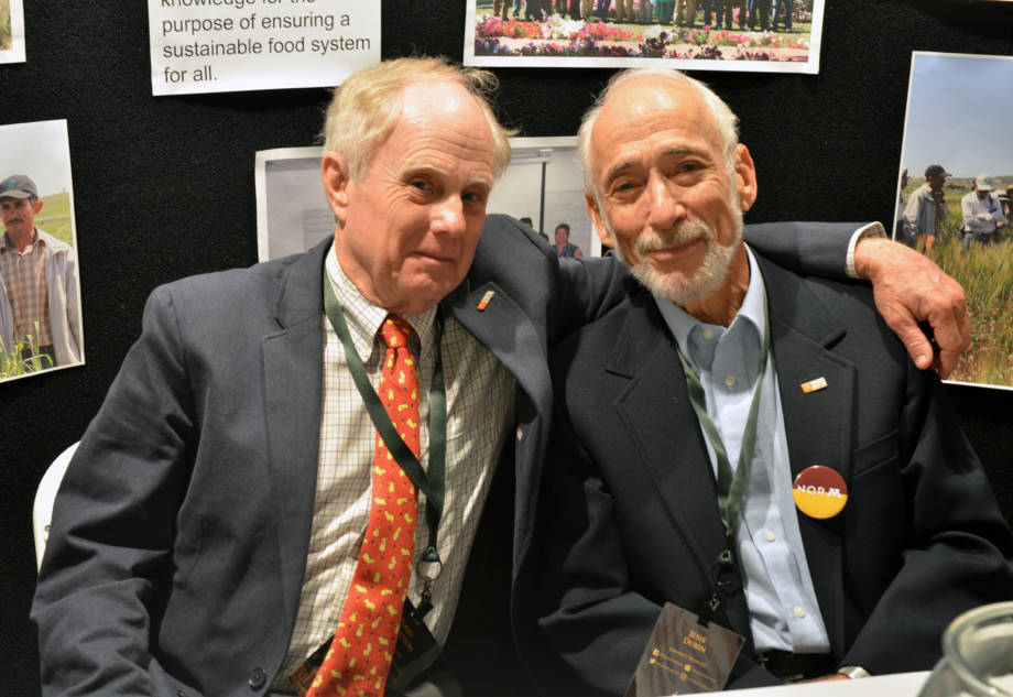 Perry Gustafson, adjunct professor in plant sciences, strikes a pose with long time friend and colleague Jesse Dubin. The two both worked in the fields with Norman Borlaug at one point in their careers.