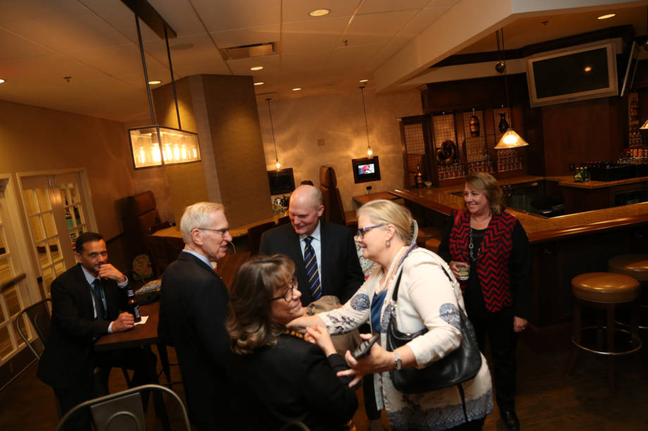 Ken Schneeberger and Christy Copeland meet with attendees of the MU alumni event in the Marriott in downtown Des Moines. Photo courtesy of The World Food Prize.