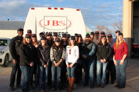Students pose by a JBS vehicle.