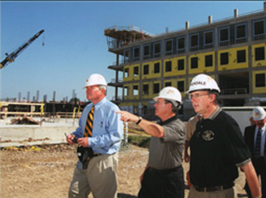 CAFNR Dean Tom Payne surveys the construction of the Christopher S. Bond Life Sciences Center in the early 2000s. To his right is Mike Chippendale, the center's first director.
