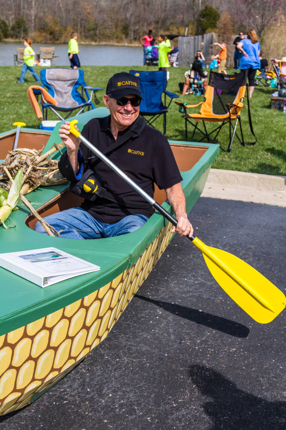 CAFNR Dean Tom Payne shows off CAFNR's submission, a corn-themed vessel, in the 2014 edition of the Float Your Boat for the Food Bank event at Bass Pro Shops Lake. Photo by Aaron Duke.