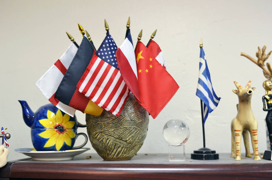 The office of Nicholas Kalaitzandonakes has a vase with several international flags, representing the countries of his fellow EMAC team members.