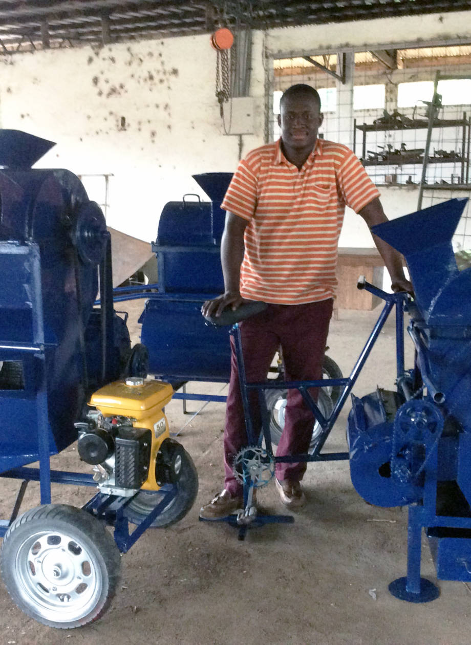 Gabriel Abdulai stands next to a group of threshers in Ghana that he helped design and provide training to for local farmers. Abdulai is currently working on his master's in bioengineering after meeting and being encouraged by Kerry Clark to apply to the program. Photo courtesy of Kerry Clark.