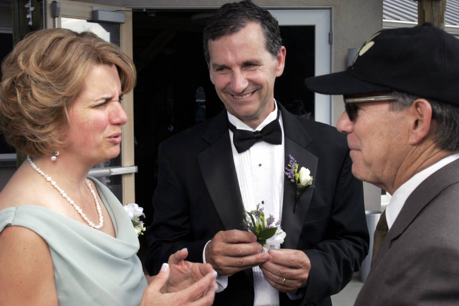 John Gardner and his wife, Julie, talk with Dean Payne at the wedding of THEIR DAUGHTER KATE IN YEAR. Photo courtesy of John Gardner.