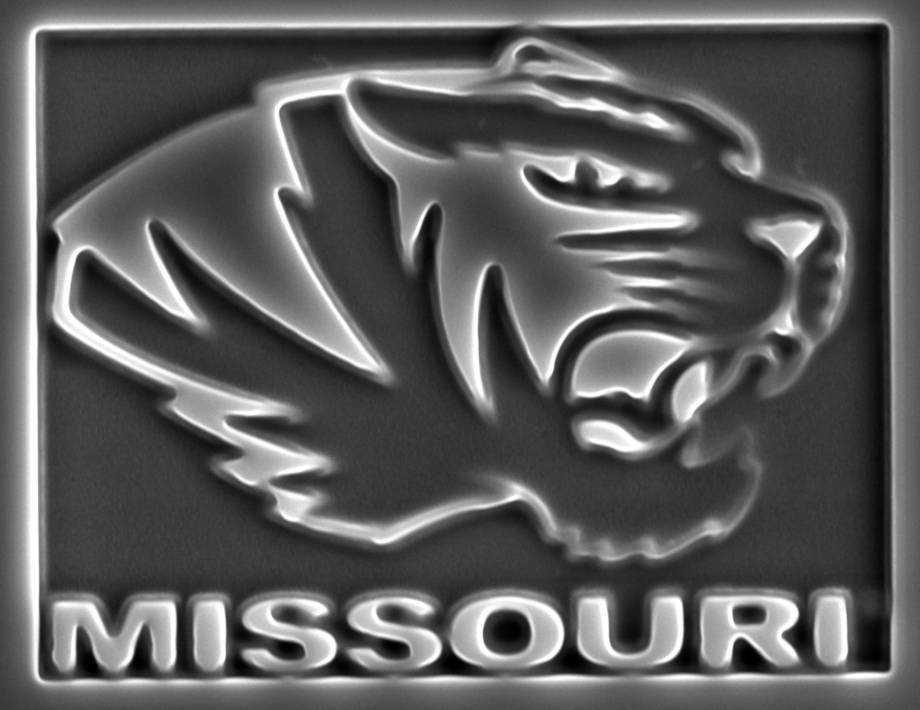 "This MU Tiger head logo was created using the new FIB-SEM microscope. Each letter in ""Missouri"" is less than five microns in size. Image courtesy of Tommi White."