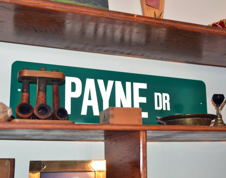 A replica of the sign of Payne Drive near the Ohio Agricultural Research and Development Center in Wooster, Ohio, sits in CAFNR Dean Tom Payne's home office. Photo by Stephen Schmidt.