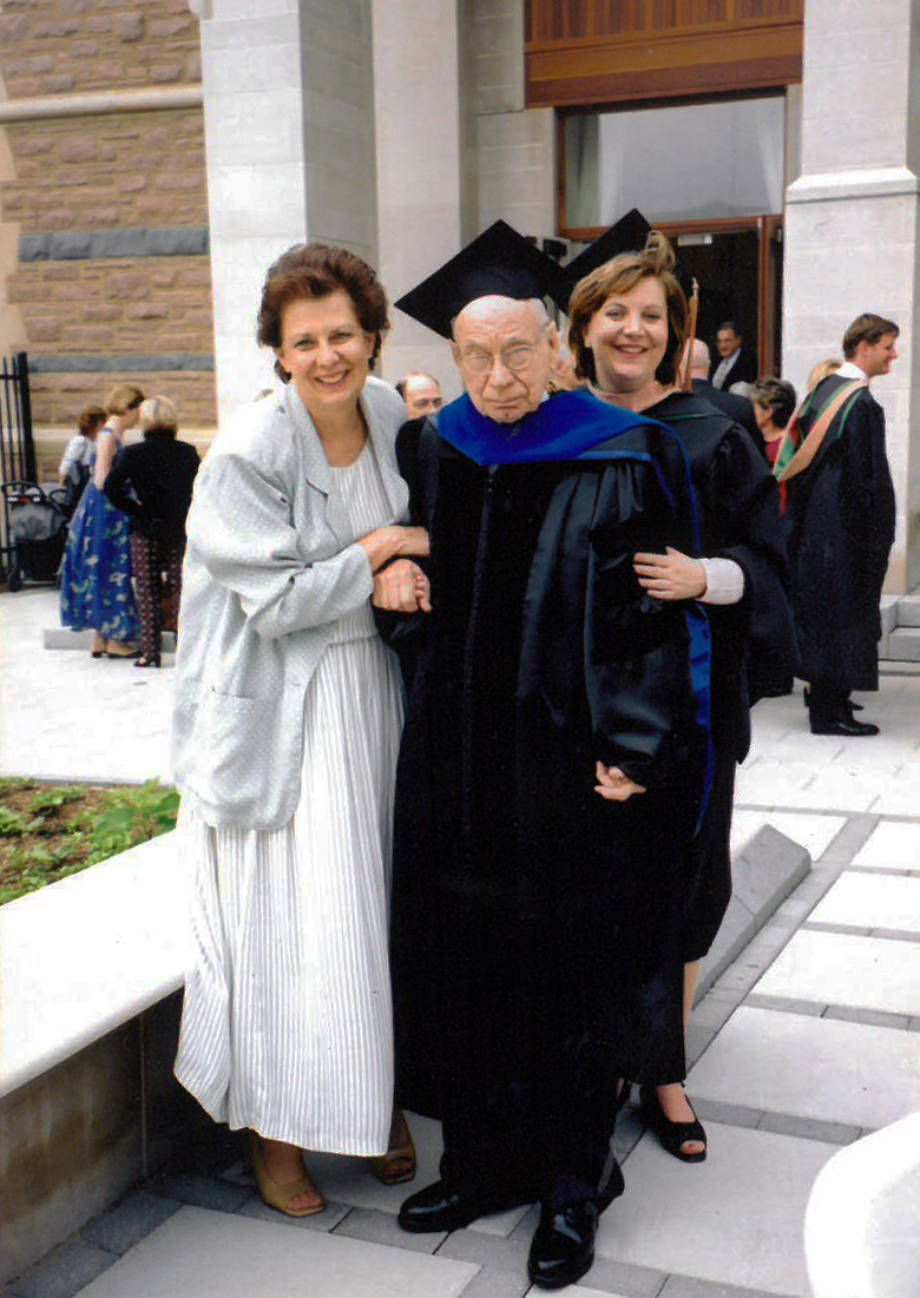 Carolyn Wenneker, left, Homer Patrick, and Robin Wenneker pose for a photo on Robin's graduation from her MBA program at Washington University in St. Louis in 2002. Patrick wore an old graduation gown of his for the occasion. Photo courtesy of Robin Wenneker.