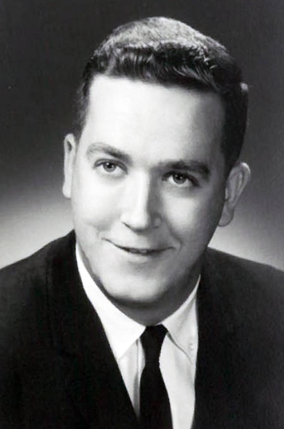 Ron Wenneker, in his early 20s. This is believed to be one of the first professional photos that he had taken after becoming an insurance agent. Photo courtesy of Robin Wenneker.