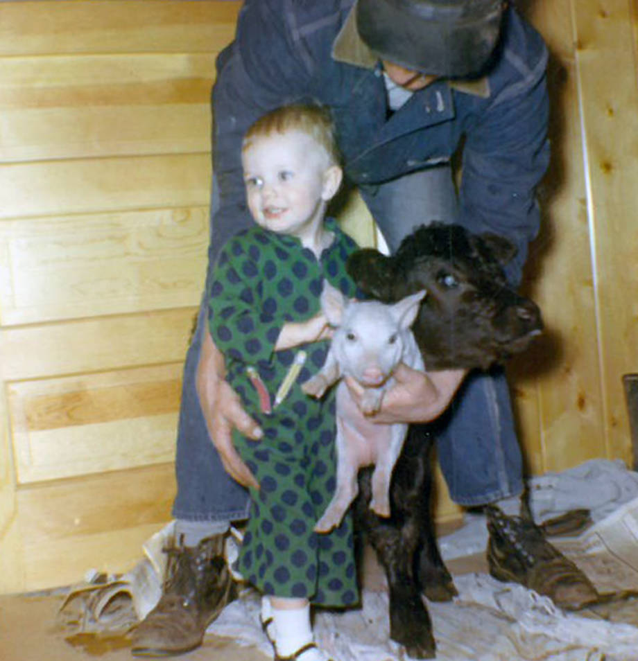 A 2-year-old Robin with a pig and a calf. Robin spent her childhood helping take care of animals on the weekends at her family's farms. Photo courtesy of Robin Wenneker.