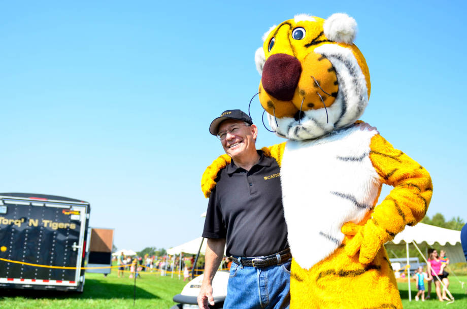 CAFNR Dean Tom Payne strikes a pose with Truman at the 2014 version of the South Farm Showcase. Tom had helped spearhead the event after having success overseeing a similar event at Ohio State in the '90s. Photo by Morgan Lieberman.
