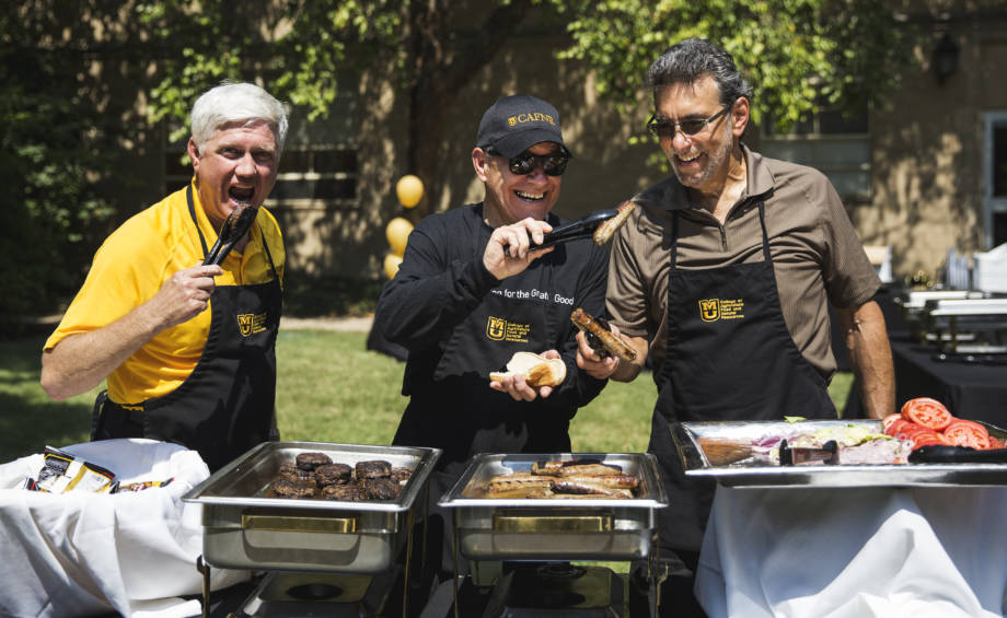 The three CAFNR deans (Bryan Garton, Tom Payne and Marc Linit) have a little fun while serving food at a faculty/staff appreciation lunch event last year.
