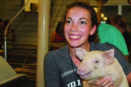 Student with pig