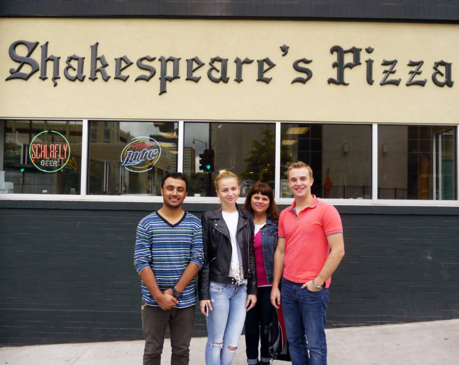 Shakespeare's Pizza was one of the favorite places to spend time for the four Ukrainian professors. Pictured (from left): Habibullah Habibullah, a master's student from Pakistan, Elena Charniavska, Olga Yatsenko and Dima Didukh. Photo courtesy of Linda Journey.