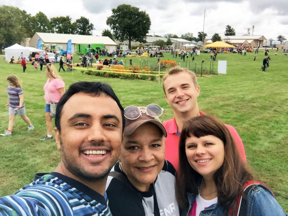 Dima Didudkh and Olga Yatsenko take a selfie at South Farm Research Center's South Farm Showcase on Oct. 1 with Habibullah Habibullah and Linda Journey, business support specialist for CIP. Photo courtesy of Linda Journey.