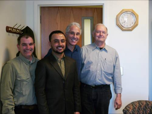 Habibullah stands with Kelly Nelson, Peter Motavalli, and Robert Kremer at his thesis defense presentation on Feb. 16.